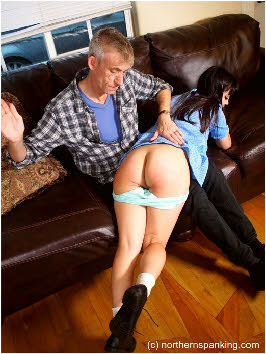 Spanker aims strike at young girl's naked arse cheeks